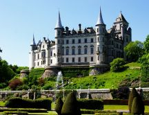Dunrobin Castle on hill  and a green garden