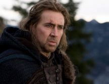 Serious looking American actor Nicolas Cage