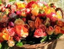 A stunning basket with colorful roses