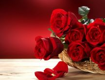 Beautiful red roses bouquet in a basket