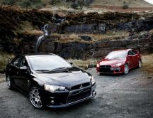 Black and red Mitsubishi Lancer Evolution in mountains