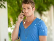 Cam Gigandet in blue T-shirt, talking at phone