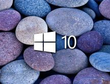 White Windows 10 on blue and purple stones