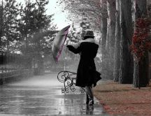 Walking in the park with an umbrella in a rainy day