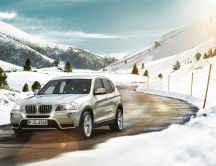 BMW on the road to the mountain - HD wallpaper