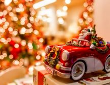 Santa is coming with a beautiful red car - Merry Christmas