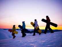 Friends on the snowboard - winter sport time