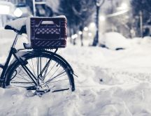 Bike buried in snow - beautiful winter season