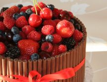 Delicious chocolate cake with berries and strawberries