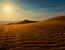 Sand dunes in the desert - wind and sun wallpaper