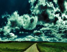 Big fluffy clouds over the green grass -Wonderful art design