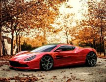 Wonderful red car in the light of Autumn sunset
