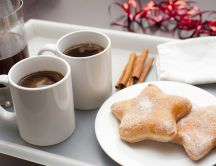 Sweet coffee with cinnamon and doughnuts