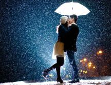 Sweet kiss under the umbrella - Wonderful snowing night