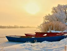 Boats on a frozen lake - Cold winter season