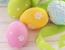 Flowers on the colored Easter eggs - Happy spring Holiday