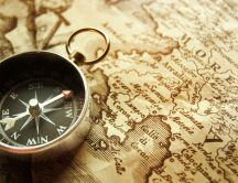Voyage around the world - Old map and compass