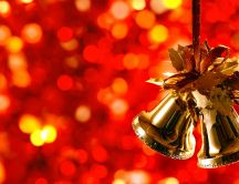 Golden Christmas bells and a wonderful red background