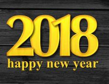 Yellow message on the wood - Happy New Year 2018