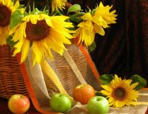 Sunflowers in a bascket and delicious summer apples
