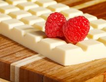 Delicious raspberry and a piece of white chocolate