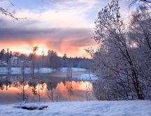 Wonderful red sunset mirror over white snow-Winter season