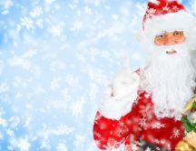 Santa Claus with Christmas tree - Winter season holiday