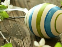 White blue and green Easter egg - Blossom flowers on a table