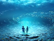 Anime boy and girl in the middle of the ocean with fishes