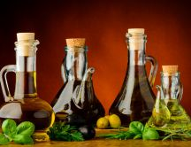 Oils bottle with different vegetable oils -olive basil plant