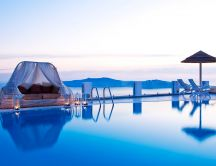 Romantic blue night on the pool-Summer holiday infinity pool